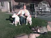 Dr. Antonio Nores Martinez with two Dogo Argentino dogs
